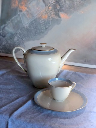 teapot, cup, plate and linen
