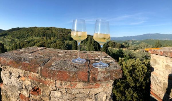 2 glasses of chilled Barbì wine on the tower crenellation