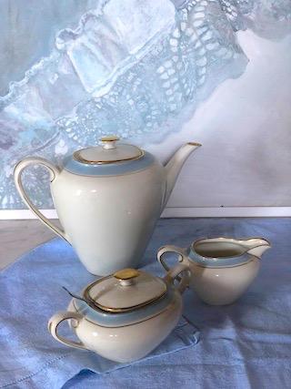 Tea pot, milk jug and sugar bowl